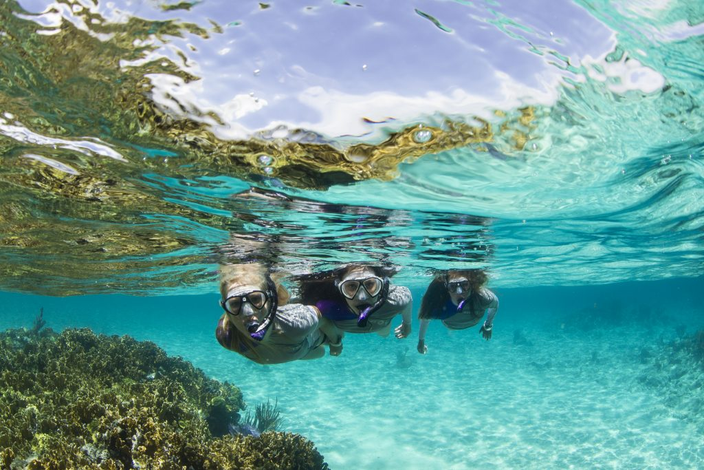 Three girls snorkeling at Aruba
